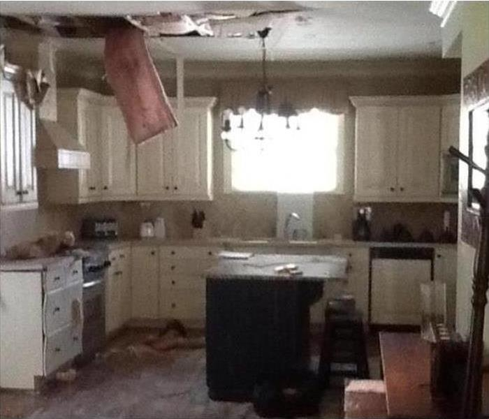 Storm-Induced Damage to a Canoga Park Kitchen Before