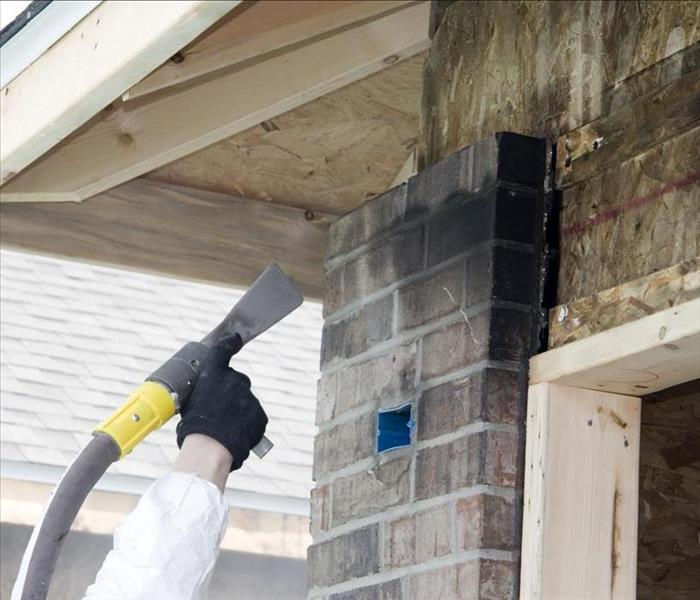 Cleaning fire damaged brick on brick house