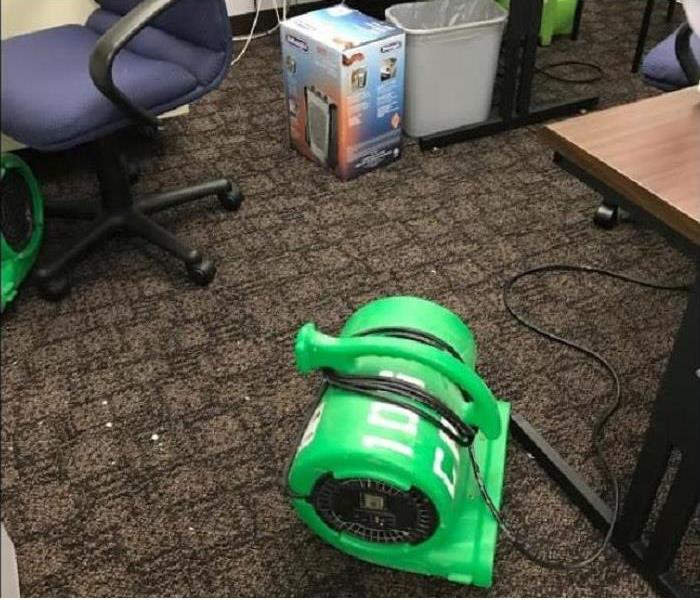 SERVPRO drying equipment being used on water damaged carpet