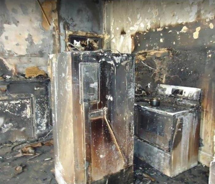 fire damaged kitchen, heavily damaged
